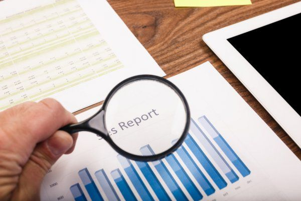 depositphotos_57362675-stock-photo-businessman-checking-a-report
